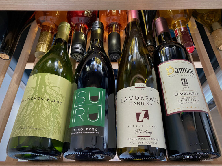 four bottles of wine in wine rack