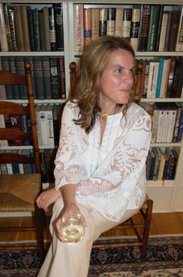 woman sitting with wine glass in her hand