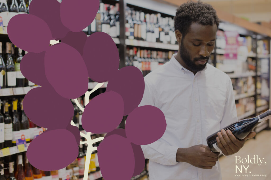 Image of man considering bottle of wine in a wine shop. Illustration of grapes and Boldly, NY. logo added to image.
